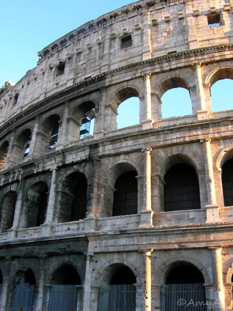 Coliseum, Rome. I love this city. I'm told that you're not allowed to touch the Coliseum. I don't know if that's true or not but it wasn't the case when I was there in November 2005. I have a picture somewhere of me touching it.  consider myself lucky.